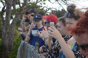 Children taking photos with their phones