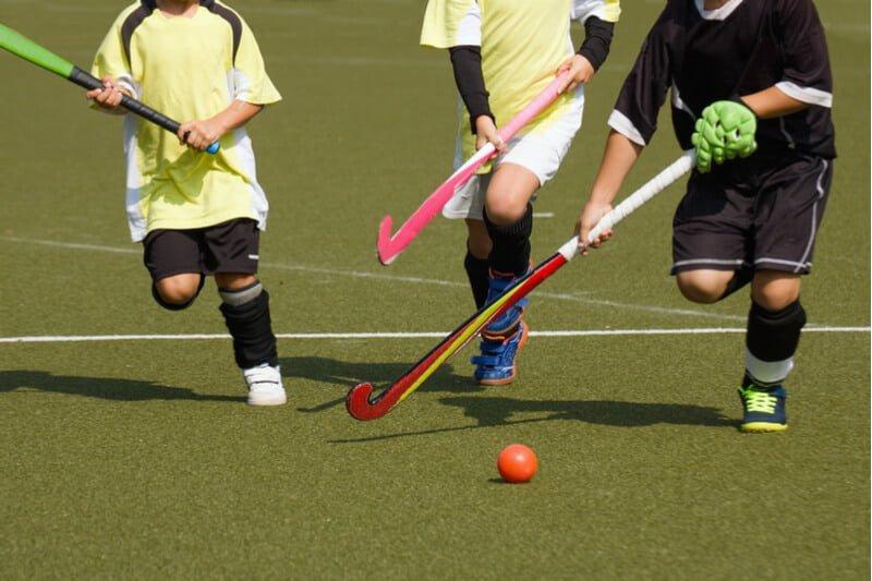 Children playing hockey to develop leadership skills