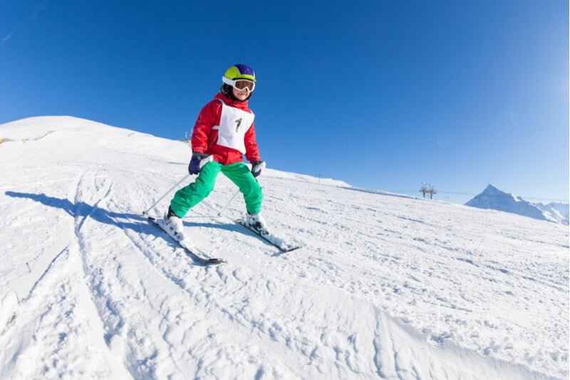 Young pupil skiing on school ski trip